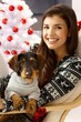 Attractive woman with dog at xmas